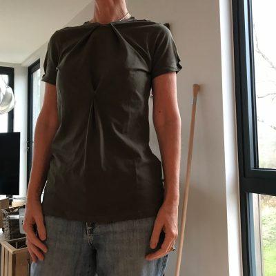 Tucks on neckline, sleeve and CF