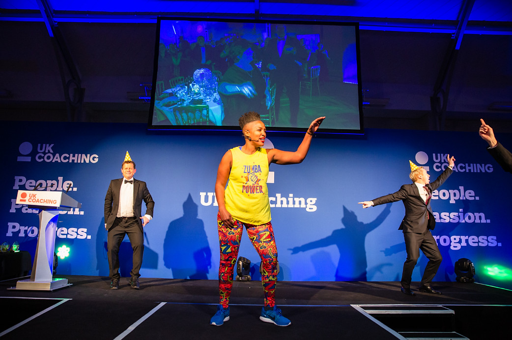 Zumba coach charm daley puts mike bushell and craig heap through their paces at uk coaching awards