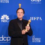 Quentin Tarantino poses backstage in the press room with the Golden Globe Award at the 77th Annual Golden Globe Awards at the Beverly Hilton in Beverly Hills