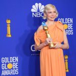 Michelle Williams poses backstage in the press room with the Golden Globe Award at the 77th Annual Golden Globe Awards