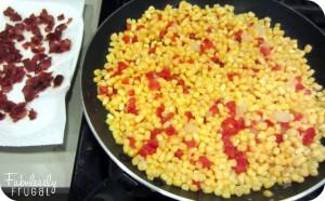 creamy confetti corn in skillet cooking