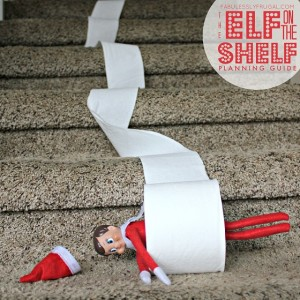 Funny Elf on the Shelf idea: Toilet Paper Roll down stairs