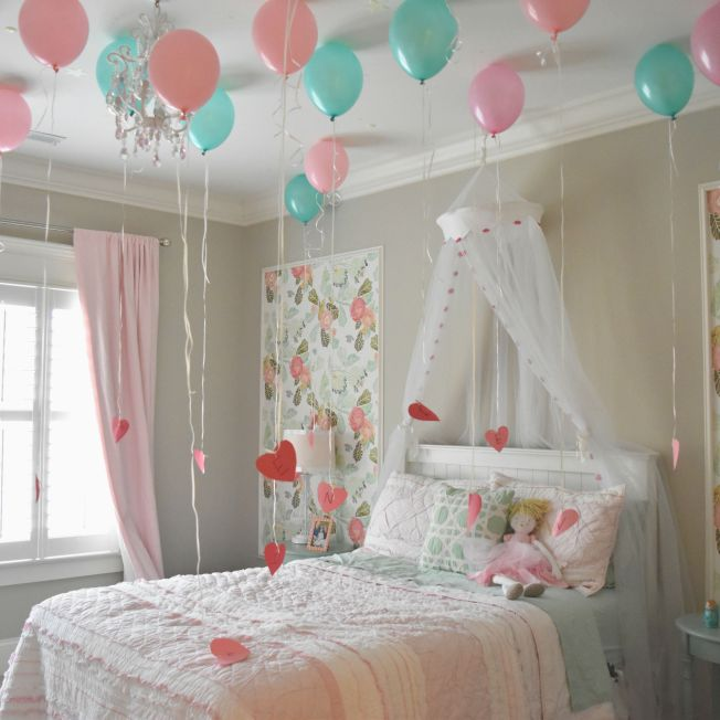 Balloons above bed Valentine's Day idea