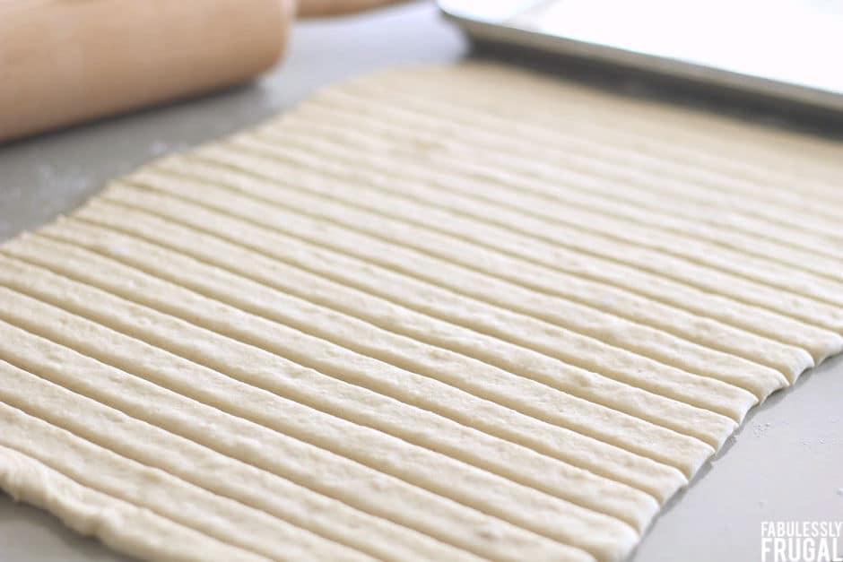 cutting homemade breadsticks