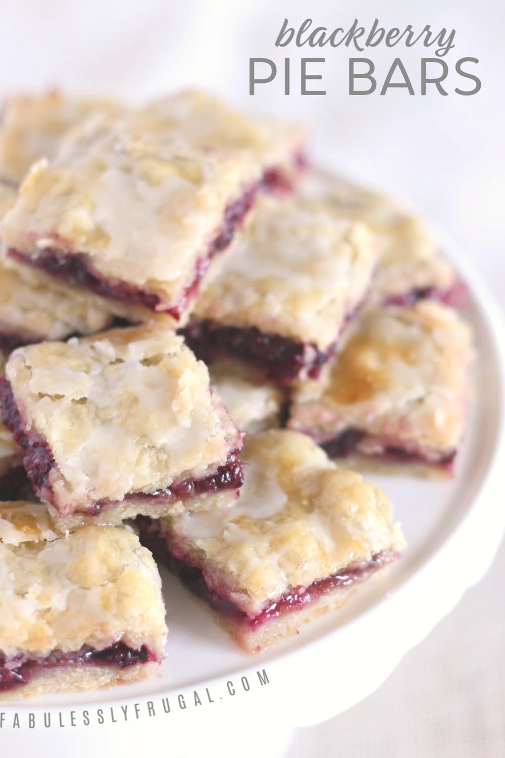 Blackberry pie bars sitting on a plate