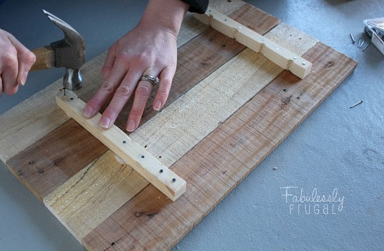 nail in back pallet board string art love