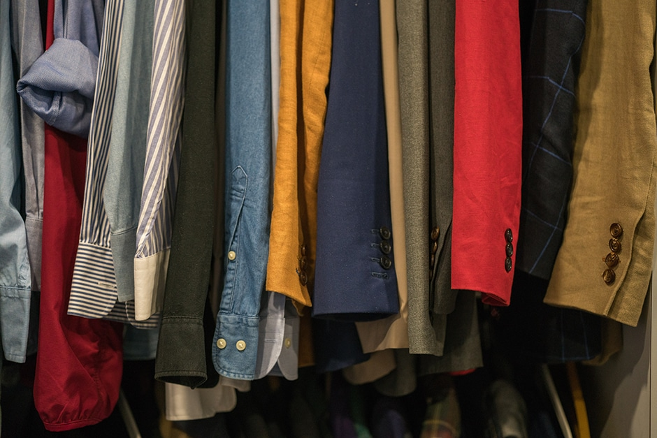 Assortment of clothes hanging in a closet