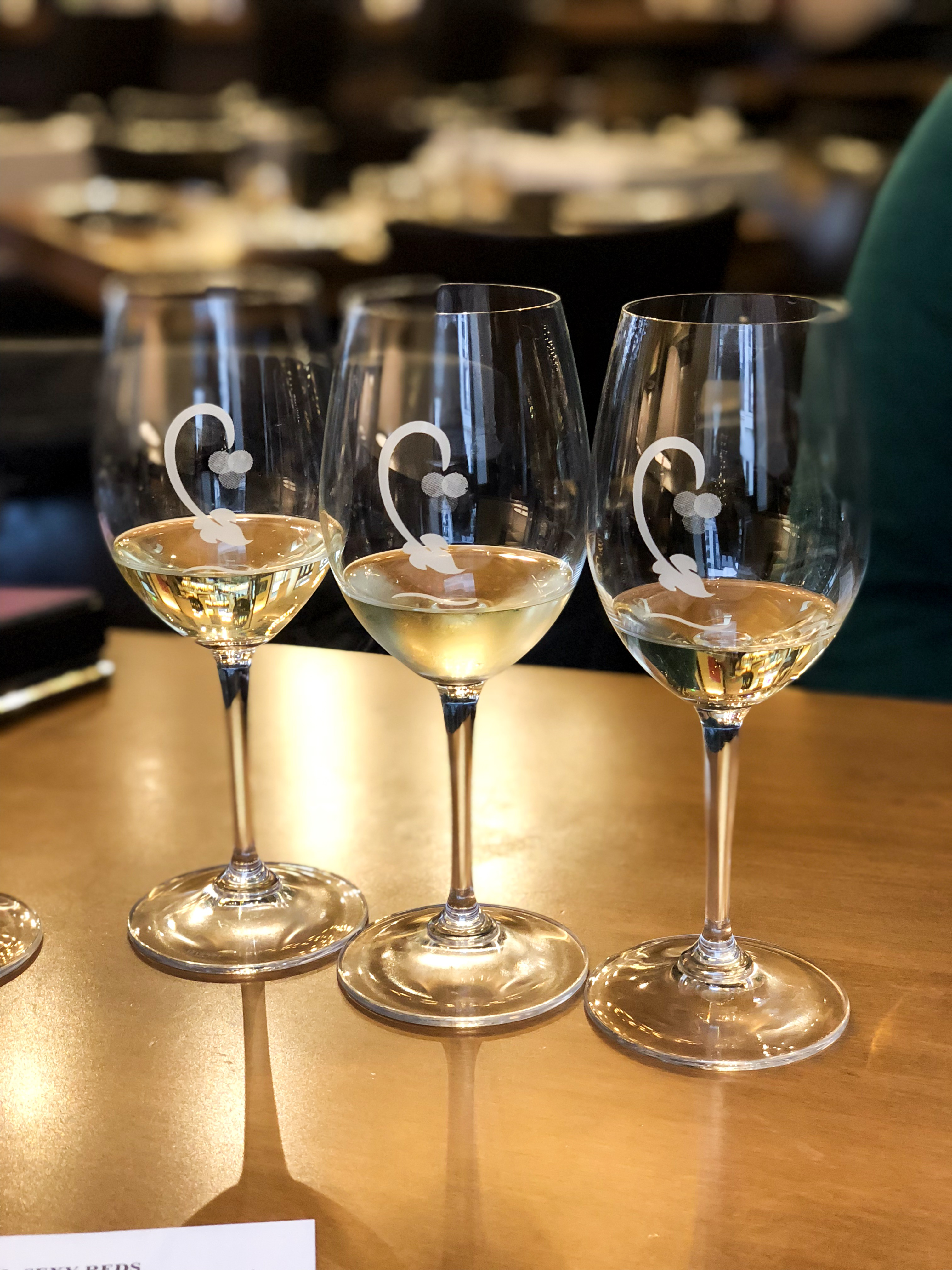 Three glasses of white wines that is part of a wine flight at Cru Food and Wine Bar