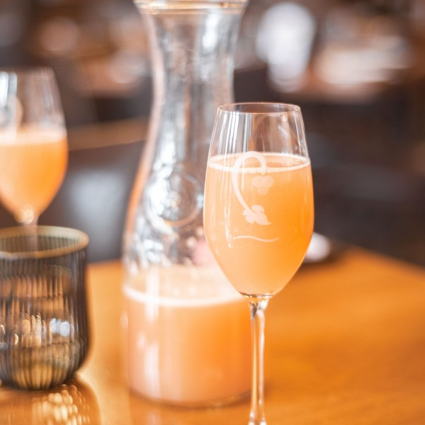 Bellini Cipriani (ruffino prosecco, white peach puree) in a glass