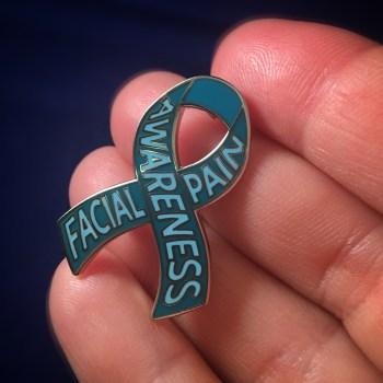 Facial Pain Awareness lapel pin