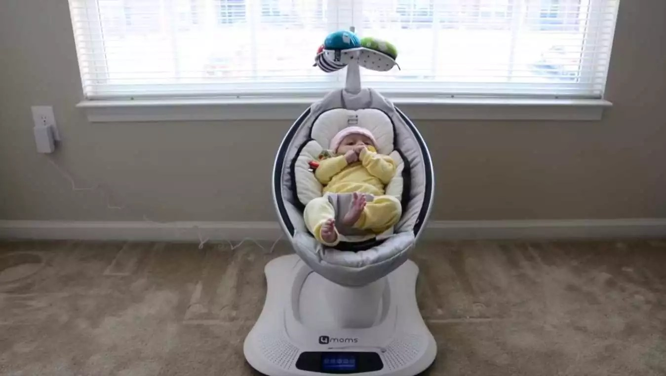 baby nap in swing