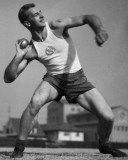 12 Jan 1932, Los Angeles, California, USA --- 1/12/1932-Los Angeles, CA- Fully recovered from a broken shoulder suffered in a football game, Herman Brix, world record holder in the shot put, is seen during practice, as the Los Angeles A.C. track team prepares for the Olympic tryouts. --- Image by © Bettmann/CORBIS