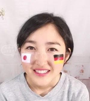 日本とドイツの国旗_フェイスペイントの画像