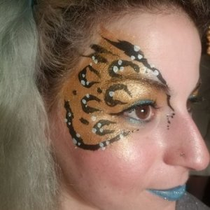 Leopard Lady sparkling face painting