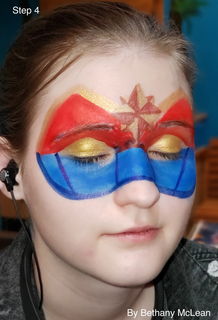Step-By-Step tutorial for Captain Marvel inspired face paint by Bethany McLean