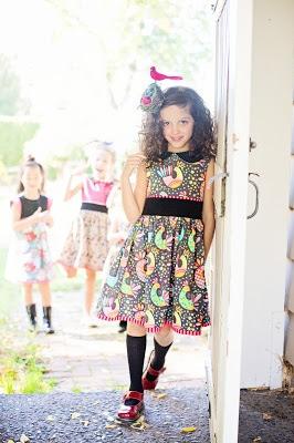 Girl in dress leaning against door
