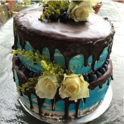 Chocolate fudge and red velvet layers with Swiss meringue icing and chocolate glaze