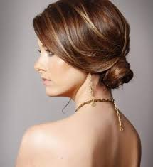 5 Sensational Hairdos for the workplace-Low Twisted Chignon Side Swept