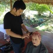 Chuan cutting Dianna's newly dyed pink hair.