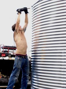 Hot guy building the water tank.
