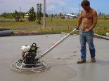 Polishing the concrete.