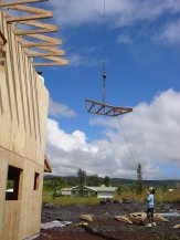Roof trusses being craned on.A
