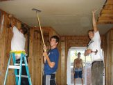 The Tarptown boys hanging drywall.