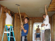 The Tarptown boys hanging drywall.