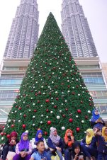 One would think that one could avoid Christmas in a Muslim country. Fat chance. It's another chance for shopping and sitting under the shade of a giant plastic tree. Bah humbug.