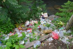 The river where we bathed in the sacred waterfall right next to the sacred plastic trash pile sliding into the river.