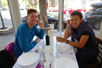 Tom and Chuan over dinner