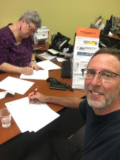 signing papers for the sale of the Hawaii house for the 5th time