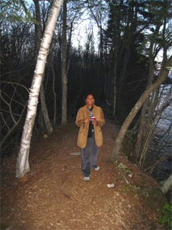 Photo of Emily walking in the woods