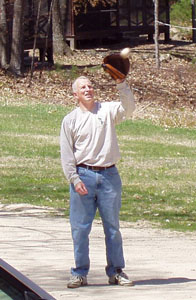 Jim S outside catching a ball with a baseball glove