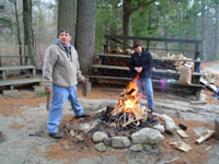 Photo of Ken and Jane standing by the campfire