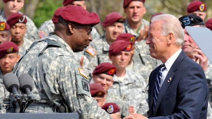 Lloyd Austin pictured with Joe Biden