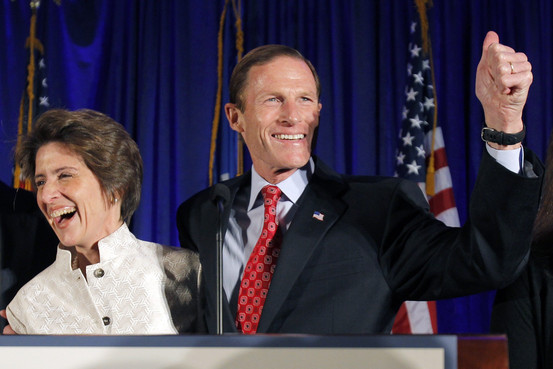 Richard Blumenthal celebrates his 2010 victory with his wife Cynthia Malkin REUTERS