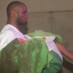 The photo of a man carrying a woman wrapped in a blood stained Nigerian flag is not from Lekki Toll Gate incident