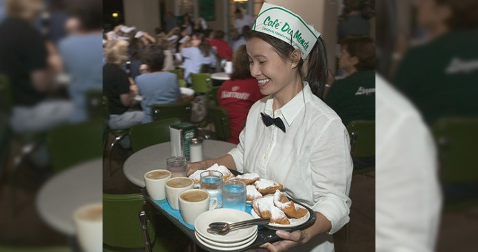 A waitress at a restaurant is expected to exhibit positivity, such as smiling and expressing positive emotion towards customers