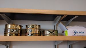Brass sieves and plastic sieves (in box)