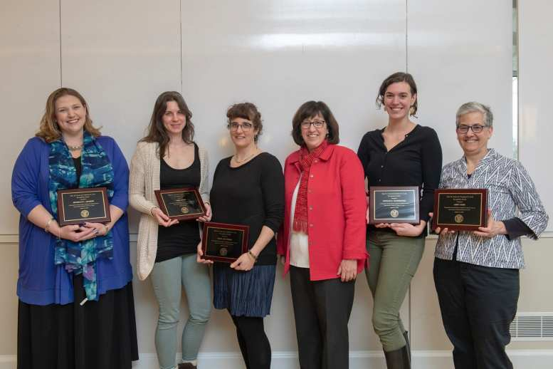 President Martha Pollack in red jacket with Cook awardees from left to right - Michelle Artibee, Tisha Bohr, Hale Tufan, Natalie Hofmeister, Abby Cohn.