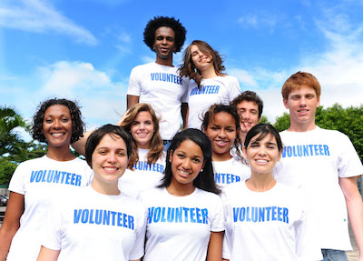 How to get students excited about volunteering photo of students wearing volunteer t shirts solutioingenieria Image collections