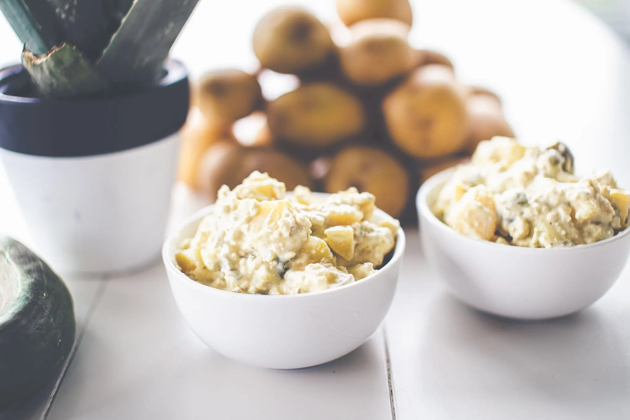 potato salad in white serving bowl on table