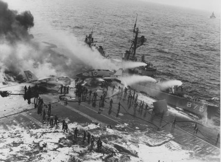 USS Rogers (DD-876) alongside the aircraft carrier USS Enterprise (CVAN-65) helping fight the fire aboard, and USS Benjamin Stoddert (DDG-22) — upper right corner — making approach to lend assistance. USS Rogers was awarded the Meritorious Unit Commendation. Photo: US Navy
