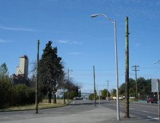 All that remains of the Portland trolley network: a few rusting poles in the traffic island on NE Broadway at Larrabee. 2006, Courtesy: Dan Haneckow/Cafe Unknown.