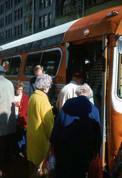 Old Trimet bus loading passengers downtown. Date unknown. Portland, Trimet