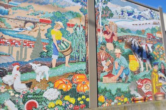 The murals depict food being transported from the four corners of the globe.