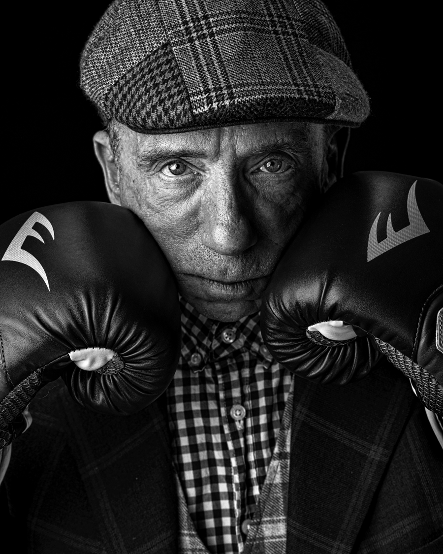 contemplating man with boxing gloves