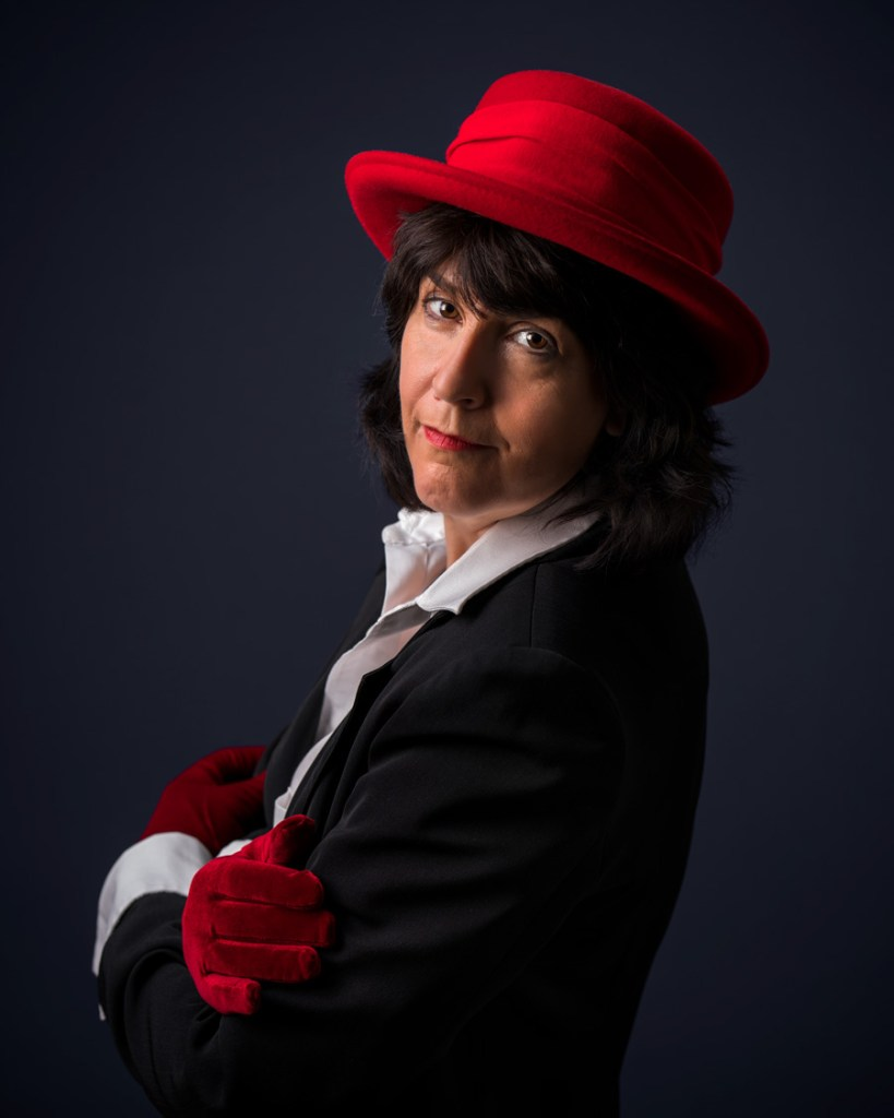 woman in red hat and red gloves