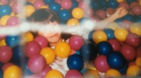 In complete bliss in the ball pit during my 8th birthday party.